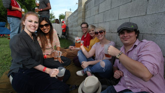 Attendees enjoy an outdoor beer festival at Mother's Brewing Company in 2014.