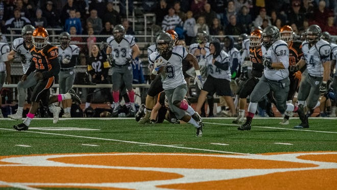 Dallastown running back Nyzair Smith breaks off one of his many big runs in his record-breaking performance in the Wildcats' 49-32 win over Central York. Smith rushed for 367 yards and five touchdowns, while breaking the program's single-season rushing record.