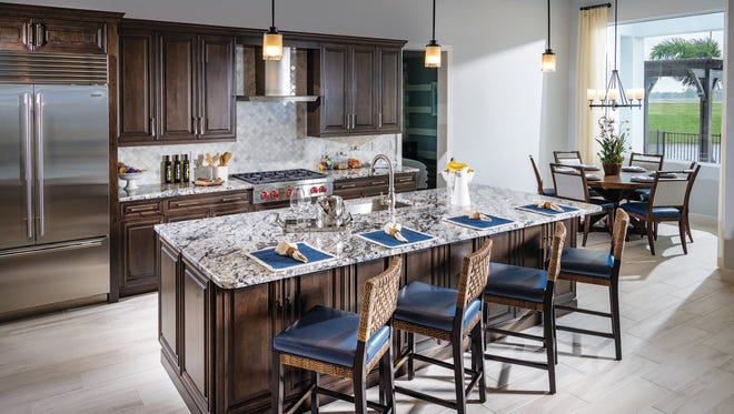 The move-in ready Aragon home at Azure at Hacienda Lakes features a gourmet kitchen like the one shown.