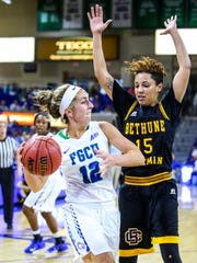 FGCU's Stephanie Haas looks to pass as Bethune-Cookman's Kendra Cooper keeps her from scoring. The FGCU women's basketball team played Bethune-Cookman, in their first round game in the Women's NIT. The game was played in Alico Arena, Fort Myers, Florida, Friday, March 18, 2016.