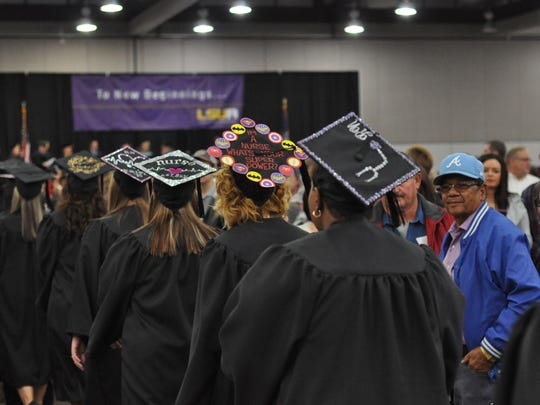 Louisiana State University of Alexandria students graduating with associate degrees in nursing walk toward the stage for fall commencement Thursday.