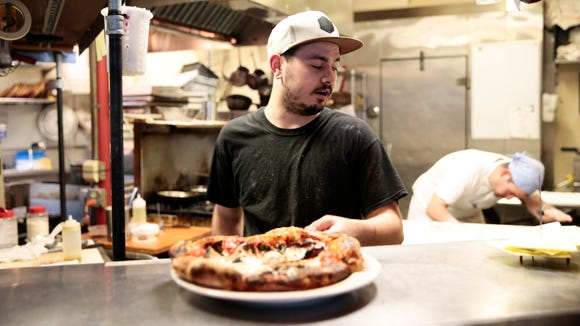 Sous chef Gabe Lee puts out a Neapolitan classic pizza at Bread and Circus Provisions' pizza pop-up night in Lafayette May 4, 2016.
