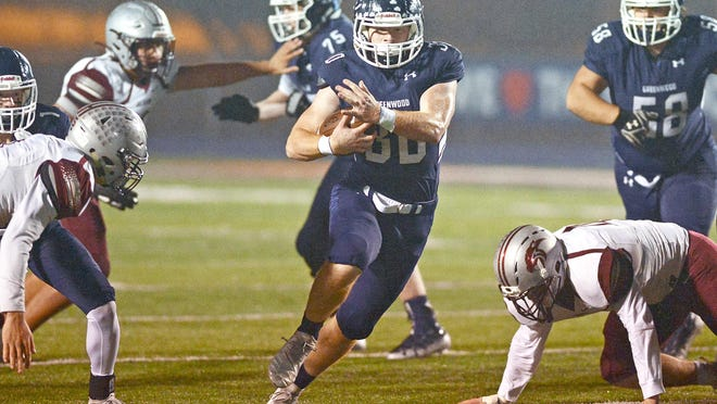 Greenwood running back Hunter Wilkinson runs up the middle against Siloam Springs on Friday, Nov. 22, 2019, in Smith-Robinson Stadium.