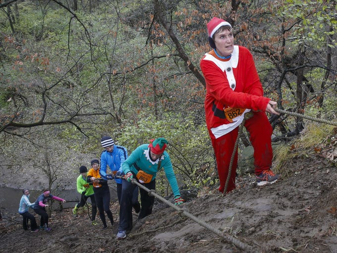 Patricia Swanson of Emmetsburg makes her way up a hill