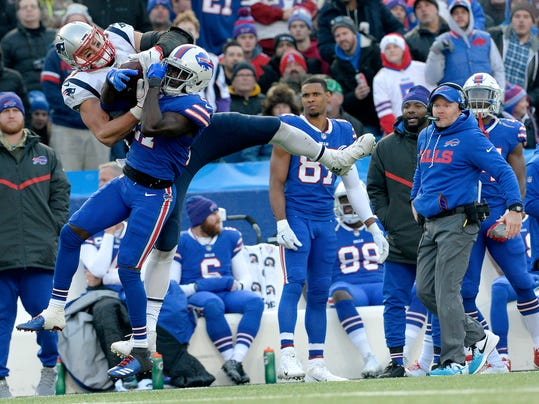 New England Patriots tight end Rob Gronkowski, left, makes a catch as Buffalo Bills cornerback Tre'Davious White (27) defends during the second half of an NFL football game, Sunday, Dec. 3, 2017, in Orchard Park, N.Y. Bills head coach Sean McDermott, right, looks on during the play. (AP Photo/Adrian Kraus)