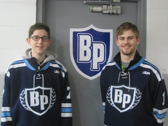 Aaron, left, and Sean Angle had a chance to skate together for the Bay Port varsity ice hockey team on Jan. 30.