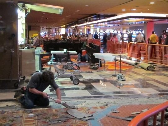 A worker rips up part of the floor at Tropicana Casino and Resort in Atlantic City, part of a $50 million renovation project.