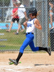 Hannah Thomson of the Oconto 12-and-under team, scores on a base hit in the second inning against De Pere on Saturday, June 30, in the annual Oconto Youth Softball Tournament at Holtwood Park.