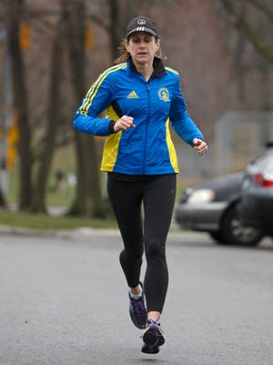 Kathy Champagne, Rochester, gets in a last short training run for the Boston Marathon Tuesday, April 15, 2014 in Rochester.  The Boston Marathon is next Monday.