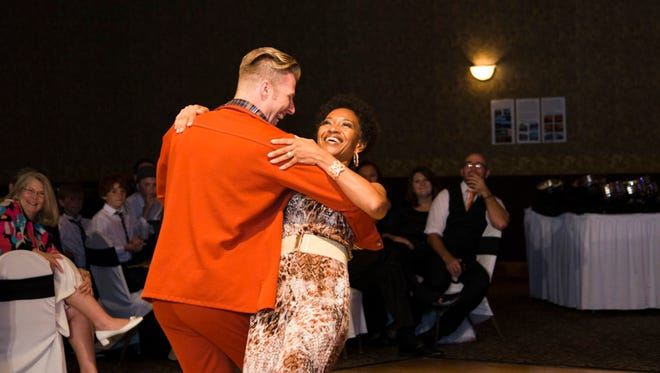 Talent Co-Champion Naima Clark from the National Labor Relations Board dances with Jeremy Mainous, owner of Arthur Murray Dance Center, Cincinnati, during the 2014 Dancing with the CLC Stars, a popular fundraiser in the region.
