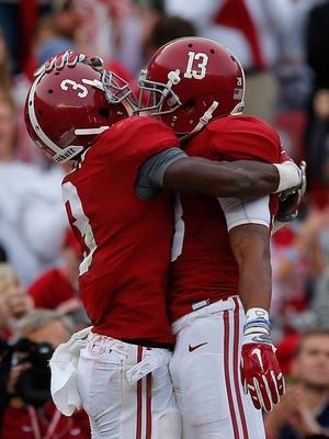 Calvin Ridley, left, and ArDarius Stewart. Alabama has a clear path to the Playoff ... if it wins out.