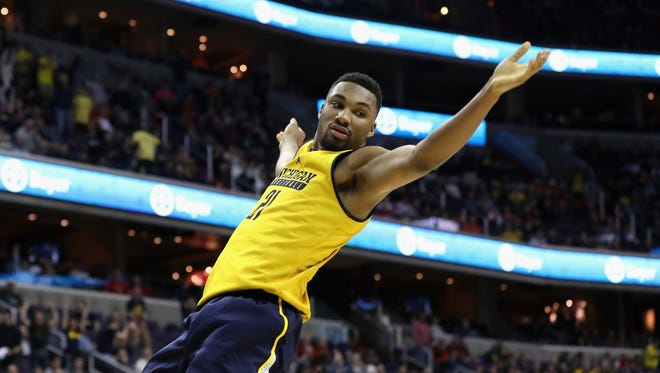 Zak Irvin of the Michigan Wolverines reacts after dunking against the Illinois Fighting Illini in the second half of the Big Ten tournament at Verizon Center on March 9, 2017 in Washington, DC.