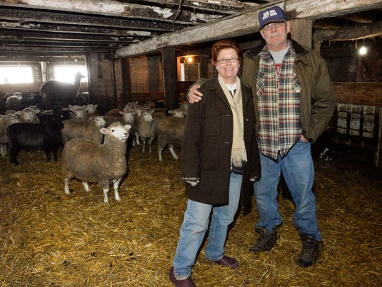 In this file photo, owner and operators Paul and Carol Wagner of Hidden Valley Farm and Woolen Mill in rural Valders pose in their sheep barn.