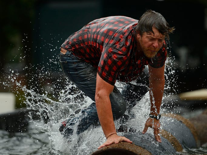 Nate Greenberg tries to keep his balance while competing in the boom run during the All American Lumberjack Show at the Brown County Fair in De Pere on Saturday, Aug. 16, 2014. Evan Siegle/Press-Gazette Media