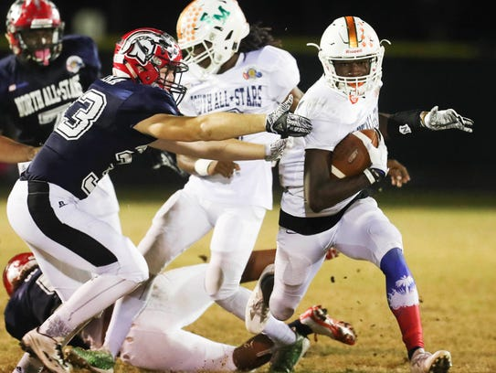 Dunbar wide receiver Shocky Jacques-Louis will choose between Kentucky, Tennessee and Pittsburgh on Wednesday.