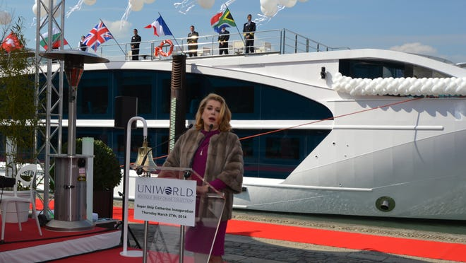 Actress Catherine Deneuve speaks at a naming ceremony for the new Uniworld river ship S.S. Catherine, which bears her name, on March 27, 2014.