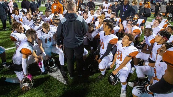 Hutto football coach Brad LaPlante, speaking to his players after a playoff game in Waller last season, said that the Hippos' game versus Cedar Ridge Friday night would be postponed due to COVID-19 issues.