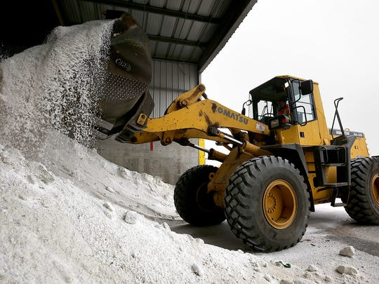 Crews load salt into a plow truck in Salt Lake City
