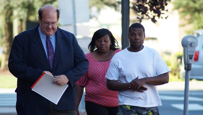 Rondaiges Harper, at right, with his attorney, John Brady, left, outside the Sussex County Courthouse in August.