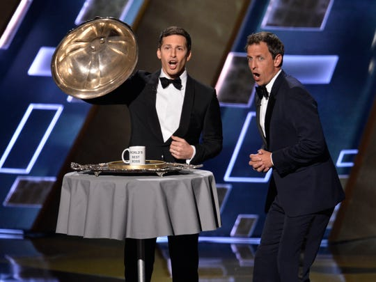 Host Andy Samberg and Seth Meyers joke during the 67th