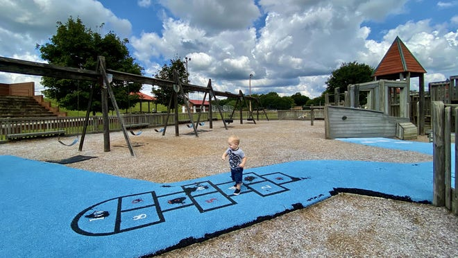 Luke Wolford, 1, spends time on the playground in Kings Mountain on Friday. Playgrounds were among many facilities to open as a part of Phase 2.5.