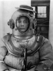 Screen comic Buster Keaton poses in character for the
