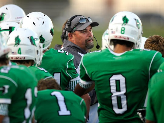 Hamlin head coach Russell Lucas talks with his players during a game last year at Shotwell Stadium in Abilene. Russell is among those scheduled to speak during the PlayMaker event Saturday.
