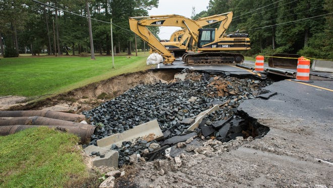 A view of a road damage on Route 12 on Saturday, Oct. 8, 2016, after heavy storms last week caused the sinkhole.
