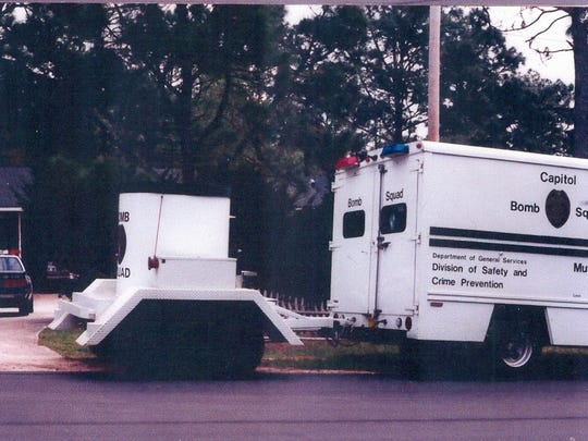 The bomb squad vehicle had a vessel hitched to it in which to transport the bomb safely.