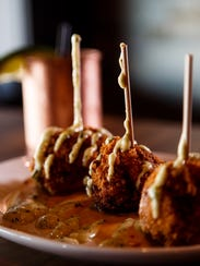 The fried mac 'n cheese balls and Moscow mule at Gilroy's
