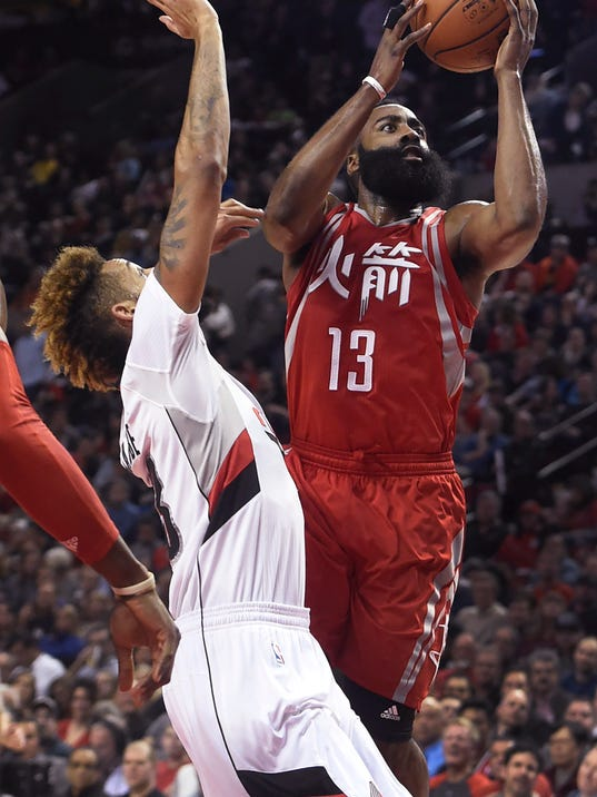 Houston Rockets guard James Harden (13) drives to the basket on Portland Trail Blazers guard Allen Crabbe during the second half of an NBA basketball game in Portland, Ore., Wednesday, Feb. 10, 2016. Portland won 116-103. (AP Photo/Steve Dykes)