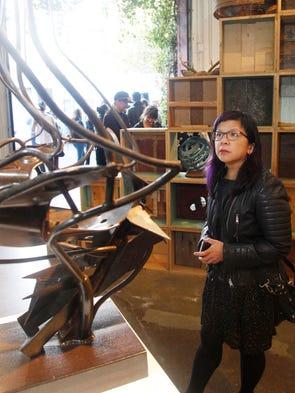 Vanessa Wang looks at a sculpture at the Detroiter,