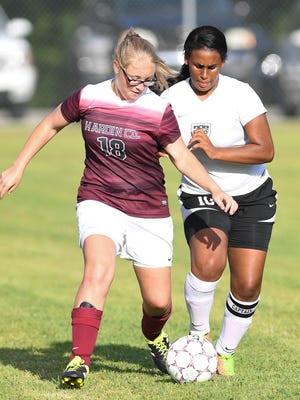 Hardin County's Kelsie Doyle and South Side's Jasmyne Bynes battle for possession of the ball during their game Aug. 24, 2017.