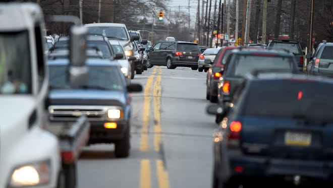 A car turns through westbound traffic along the 2000 block of East Market Street during rush hour. Improvements are coming to address crashes along the corridor, in particular, ones that occur when vehicles are turning left.