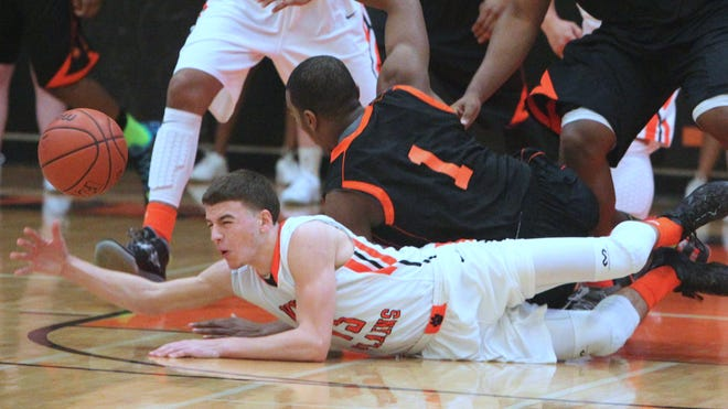 White Plains' Mike DeMello, bottom, fights for a loose ball with Spring Valley's Jordan Duncan during their Class AA quarterfinal at White Plains Feb. 20, 2014. Spring Valley won 69-66.