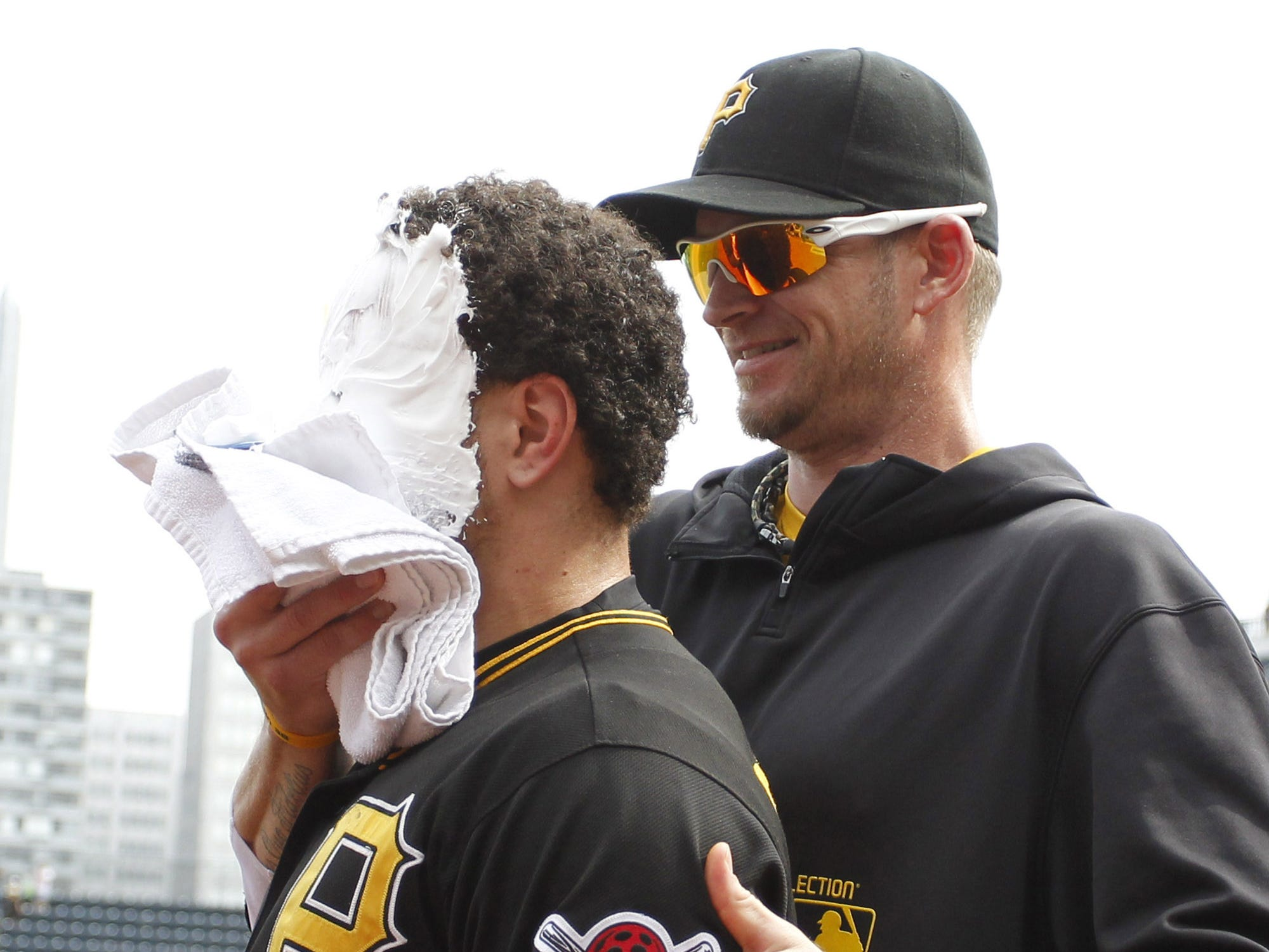 Aug. 8: Pirates catcher Russell Martin (left) receives a shaving cream pie from pitcher A.J. Burnett after Martin drove in the game winning run in the 10th inning against the Marlins.