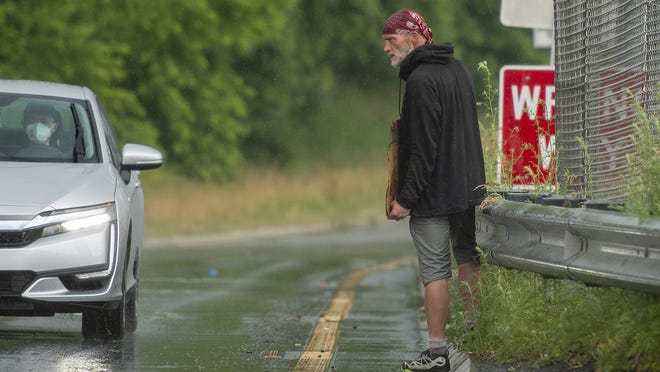 Ken, no last name given, panhandles on the Belmont Street off-ramp from I-290 on June 24.