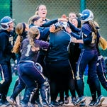 Mackinley Lane ,center, of Holt is congratulated by her teammates after hitting a 2-run homer in the 3rd inning of their Softball Classic championship game with St. Johns to cut the St. Johns lead to 1, Tuesday May 19, 2015 at Ranney Park in Lansing. Holt would go to capture its first Softball Classic title with a 6-5 extra innings victory.