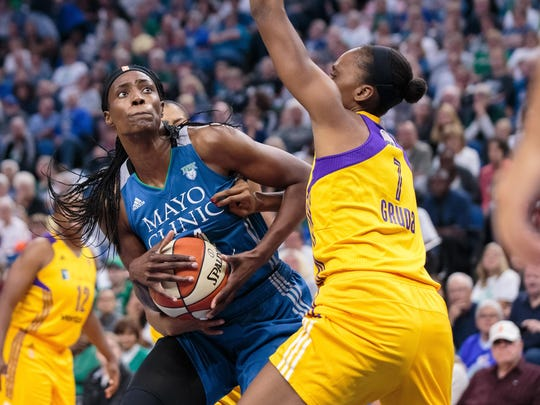 Minnesota Lynx center Sylvia Fowles (34) shoots in the second quarter Tuesday against Los Angeles Sparks forward Sandrine Gruda (7) in game two of the WNBA Finals at Target Center in Minneapolis.