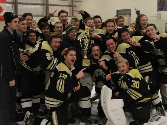 Point Boro celebrates its Winding River Holiday championship.