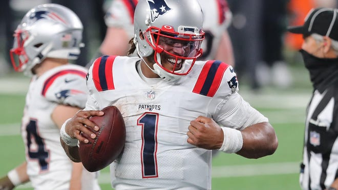 Cam Newton of the New England Patriots reacts after scoring a game-tying touchdown during the second half against the New York Jets at MetLife Stadium on Nov. 9, 2020 in East Rutherford, NJ. The Patriots won, 30-27.
