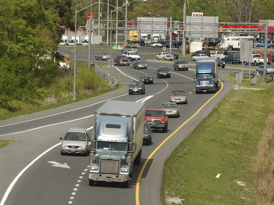 In this 2006 file photo, tractor-trailers make their