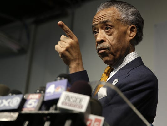 AP APTOPIX SHARPTON FBI A USA NY