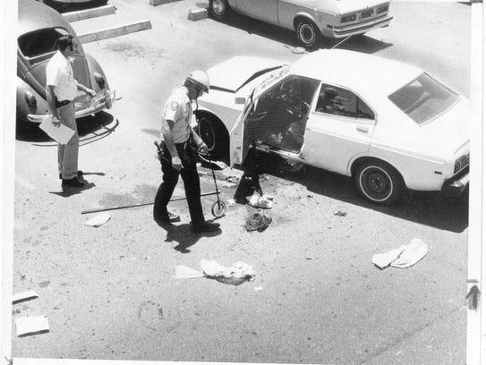 Investigators examine the car of Don Bolles, investigative