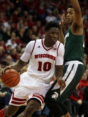 Wisconsin forward Nigel Hayes drives past Michigan State's Deyonta Davis during the Badgers' 77-76 win Sunday in Madison, Wis.