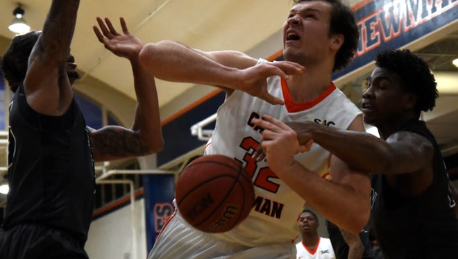 Lincoln Memorial's Dorian Pinson, right, knocks the ball free from Carson-Newman's Dmitrii Bykov  at Holt Fieldhouse in Jefferson City on Wednesday, Jan. 17.