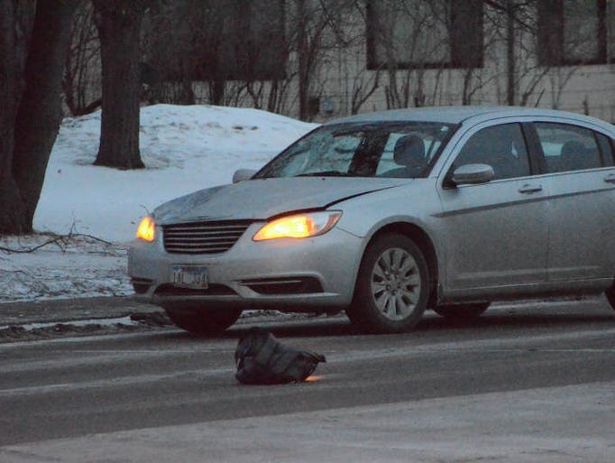 Police investigate a car vs. pedestrian accident in the Sycamore Avenue and 18th Street area. A backpack is show in the street.