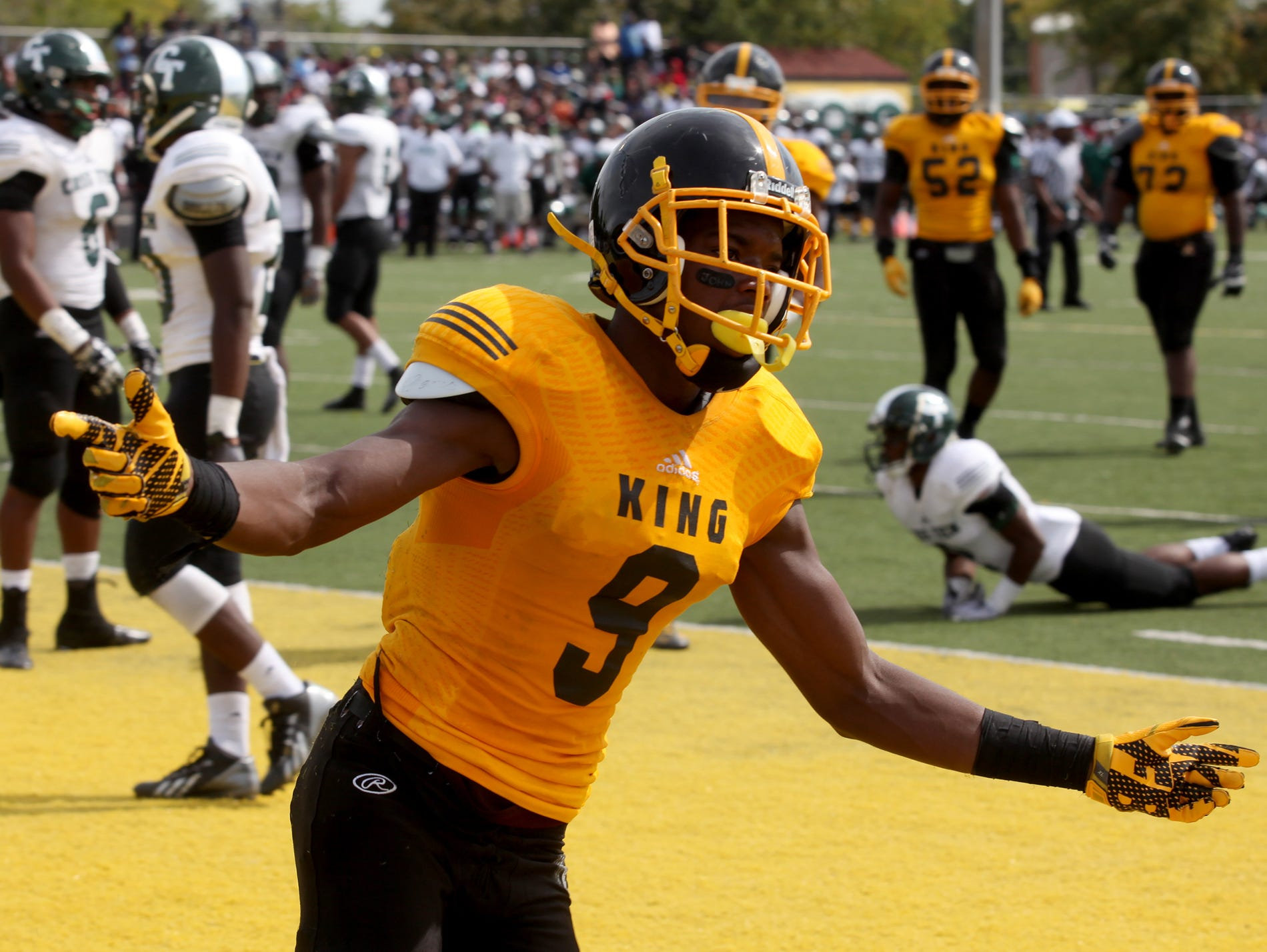 Detroit King's Donnie Corley celebrates after diving in for a touchdown in the first half during the game against Cass Tech on Sept. 26.
