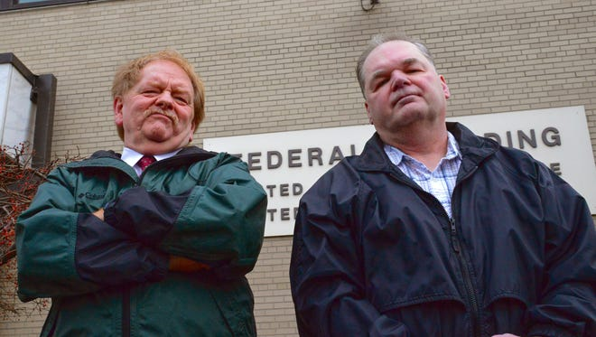 Jim Dempsey, left, and Duane Dingler stand outside the U.S. District Court building in Burlington. They both worked in the building as court security officers – Dempsey for 15 years, and Dingler for 21 years – until they were fired in 2015. They say they were fired for reporting the conduct of a lead court security officer.