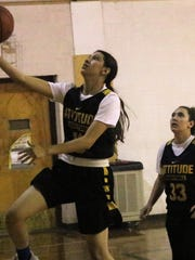 Alamogordo's Mianna Boner eyes the basket during a layup attempt.